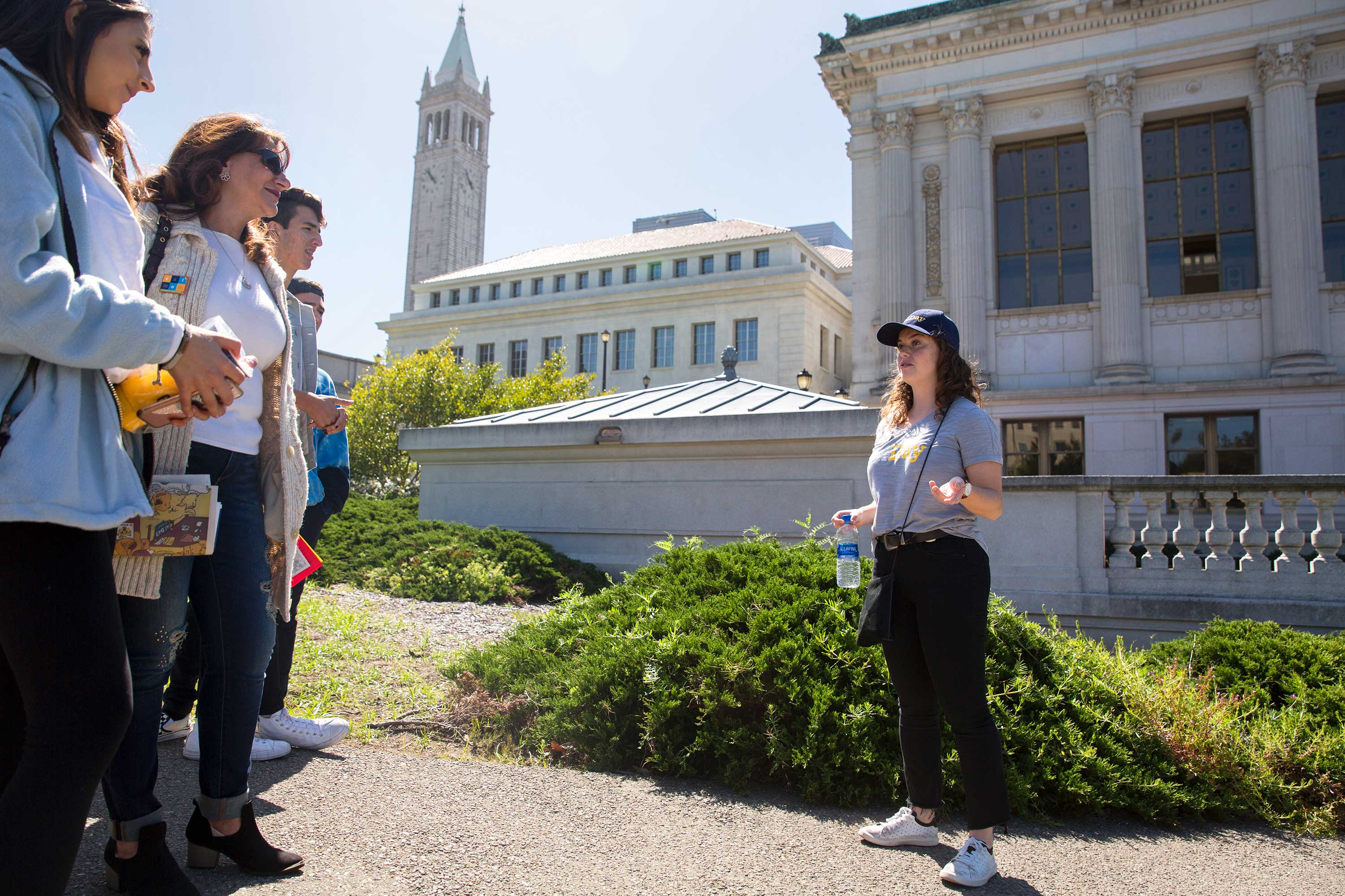 A tour guide giving a tour on the UC Berkeley campus.